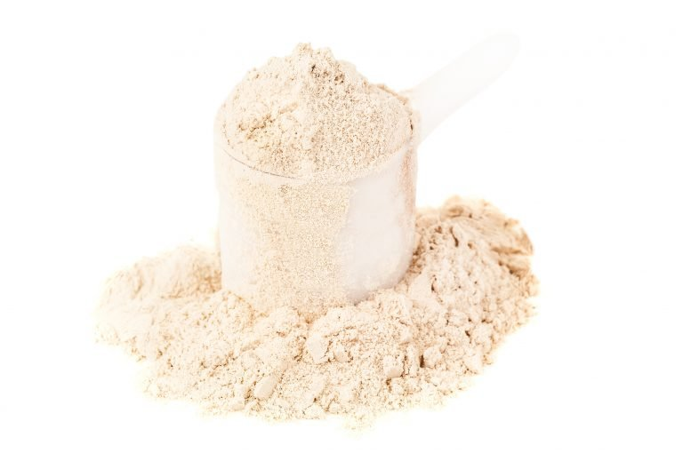 A scoop of vanilla protein powder.