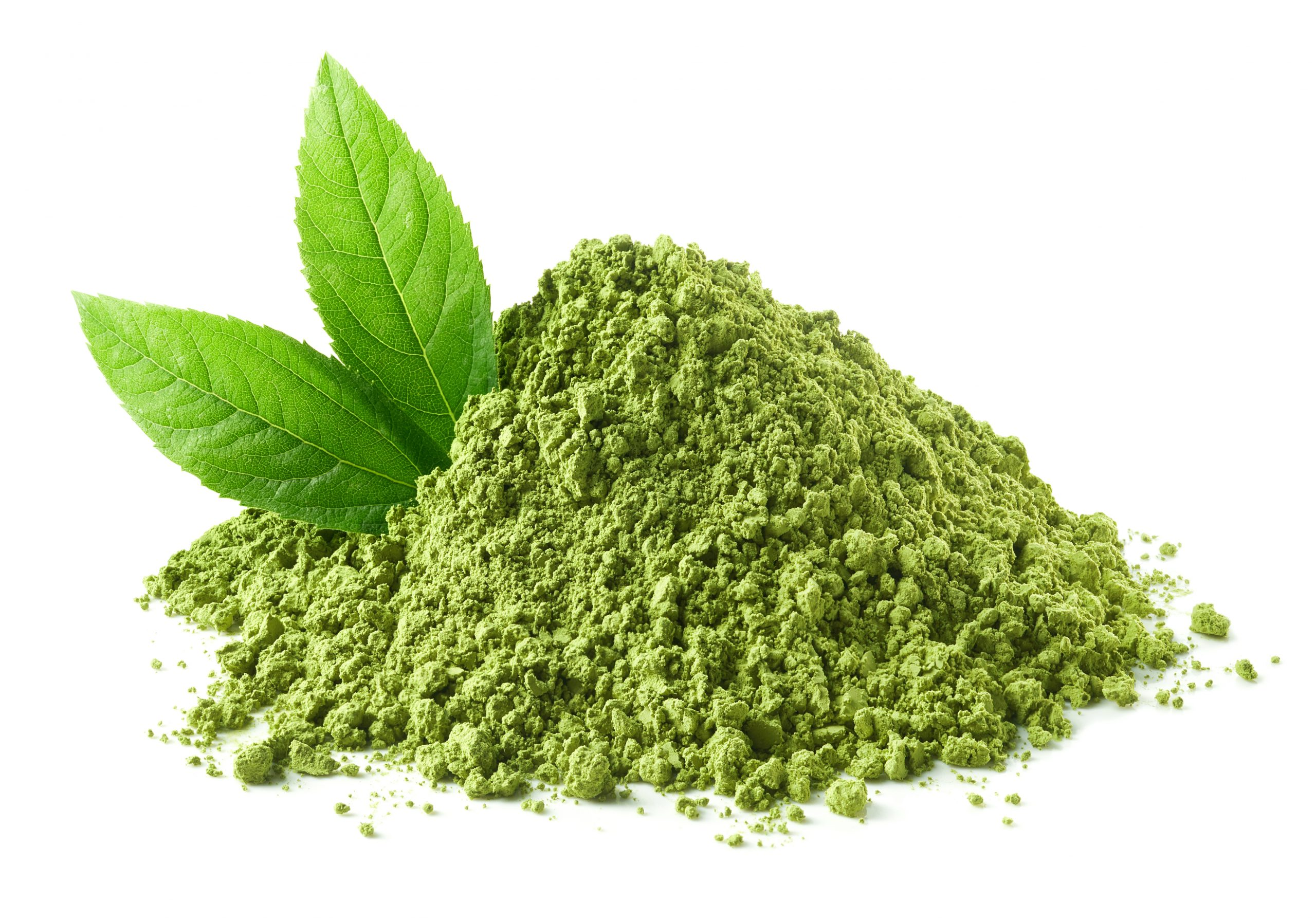 Heap of green matcha tea powder and leaves isolated on white background