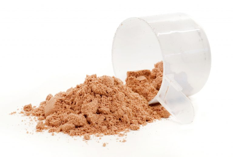 A scoop of chocolate protein powder drink on white background.
